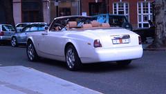 executive car(0.0), rolls-royce corniche(0.0), rolls-royce phantom coupã©(0.0), rolls-royce phantom(0.0), automobile(1.0), automotive exterior(1.0), rolls-royce(1.0), vehicle(1.0), rolls-royce phantom drophead coupã©(1.0), sedan(1.0), land vehicle(1.0), luxury vehicle(1.0), convertible(1.0), supercar(1.0), sports car(1.0),