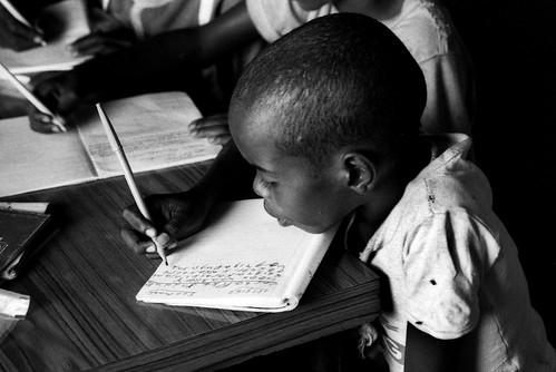 somalia597-mogadishu-orphan-boy-taking-lessons