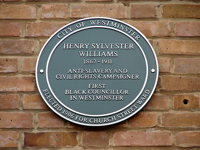 Henry Sylvester Williams green plaque - Henry Sylvester Williams  1867-1911  Anti-slavery and  civil rights campaigner  first  black councillor  in Westminster  elected 1906 for Church Street Ward