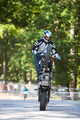 supermoto(0.0), isle of man tt(0.0), racing(1.0), vehicle(1.0), race(1.0), motorcycle(1.0), motorsport(1.0), motorcycle racing(1.0), road racing(1.0), extreme sport(1.0), motorcycling(1.0), stunt performer(1.0), stunt(1.0),