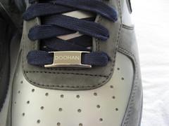 brown(0.0), leather(0.0), outdoor shoe(1.0), textile(1.0), footwear(1.0), shoe(1.0), grey(1.0), blue(1.0),