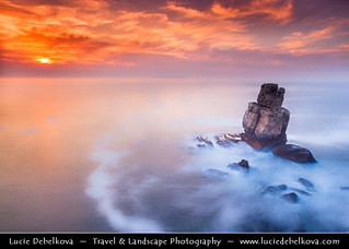 Portugal - Standing Alone under Monet like Sky- Sunset at Cliffs in Cabo Carvoeiro at Peniche
