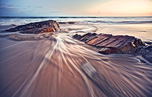 ocean longexposure sunset motion beach rock canon flow eos wave wideangle newportbeach crystalcove tone lowangle ef1635mmf28liiusm 5dmarkii