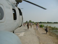 victims rushing towards the helicopter