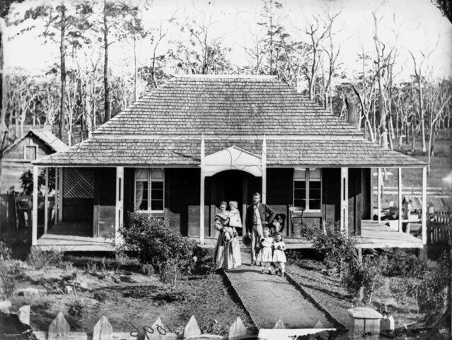 Family standing outside their homestead in the albert and for Queensland terrace state library