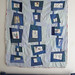 blue embroidered linen and cotton quilt