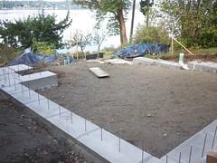 floor(0.0), backyard(0.0), outdoor structure(0.0), wall(0.0), yard(0.0), flagstone(0.0), walkway(0.0), brickwork(0.0), soil(1.0), foundation(1.0), landscaping(1.0),