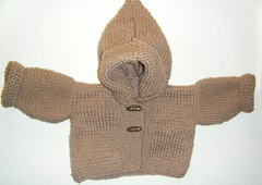 hand(0.0), cap(0.0), stuffed toy(0.0), toy(0.0), art(1.0), pattern(1.0), textile(1.0), brown(1.0), wool(1.0), clothing(1.0), outerwear(1.0), knitting(1.0), beige(1.0), sweater(1.0),