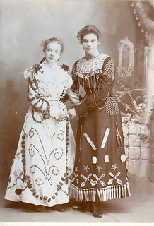 One of best Advertising cabinet photos you will ever see...Lena and Esther sisters from Mt. Ayr Iowa