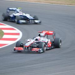 performance car(0.0), race(0.0), sports prototype(0.0), touring car(0.0), supercar(0.0), auto racing(1.0), automobile(1.0), racing(1.0), sport venue(1.0), vehicle(1.0), stock car racing(1.0), sports(1.0), automotive design(1.0), open-wheel car(1.0), formula racing(1.0), motorsport(1.0), indycar series(1.0), formula one(1.0), formula one car(1.0), race track(1.0), sports car(1.0),