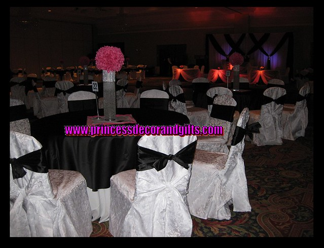 Black satin overlays and Hot Pink Centerpieces