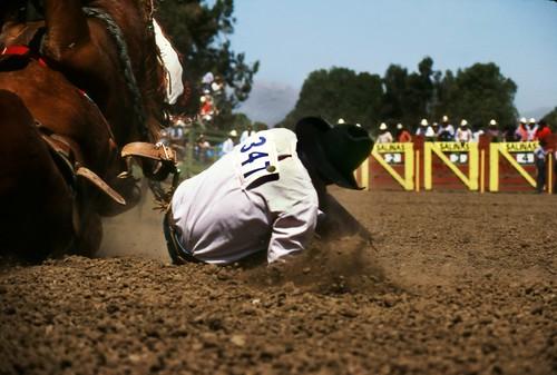 various704-salinas-rodeo-cowboy-falling-off-horse-