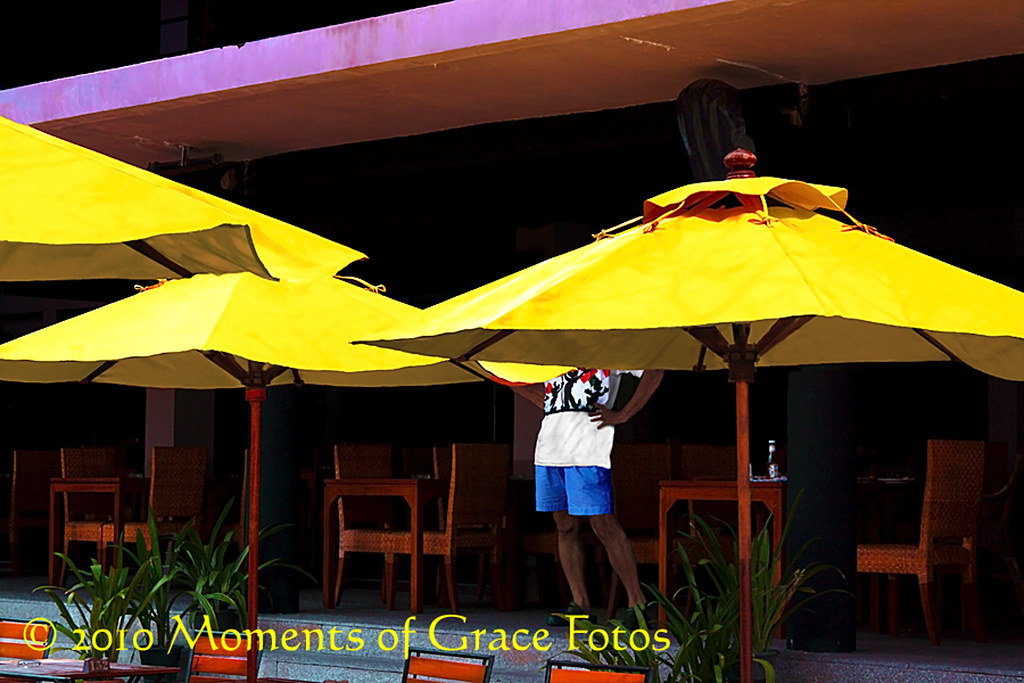 Patio Umbrellas and Tourist in the Shade, Phuket, Thailand