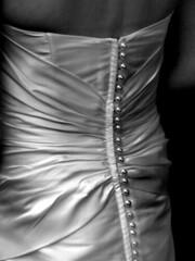 veil(0.0), chest(0.0), bridal clothing(1.0), arm(1.0), textile(1.0), clothing(1.0), monochrome photography(1.0), fashion(1.0), satin(1.0), human body(1.0), close-up(1.0), monochrome(1.0), black-and-white(1.0), dress(1.0),