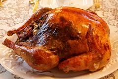 turkey(0.0), fried food(0.0), bird(0.0), meal(1.0), turkey meat(1.0), roasting(1.0), thanksgiving dinner(1.0), meat(1.0), hendl(1.0), food(1.0), dish(1.0), roast goose(1.0), cuisine(1.0), turducken(1.0),