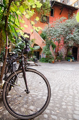 Bicycles in a courtyard of old Rome.