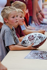Boys Waiting to have the University of Montana Football Team Autograph Their Ball