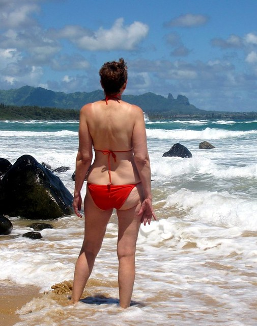 ... a red bikini and the stunning blue green mountains of Kauai.