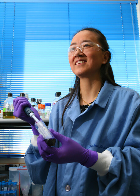Dr. Xiaoyun Lu of the Bioscience Division at Los Alamos National Laboratory (LANL) is a member of a team developing a hand-held device for rapidly detecting and identifying the influenza virus.  Photo by LeRoy Sanchez.