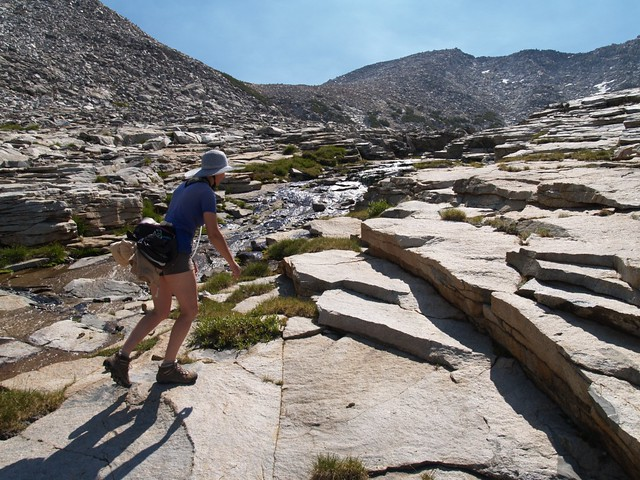Vicki climbing glaciated slabs next to Horseshoe Creek.