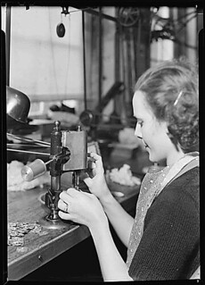 Lancaster, Pennsylvania - Hamilton Watch . Operation - tapping dial foot - simple operation for threading holes in parts., 1936 - 1937