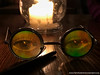 Harry Potter glasses and wand by candlelight