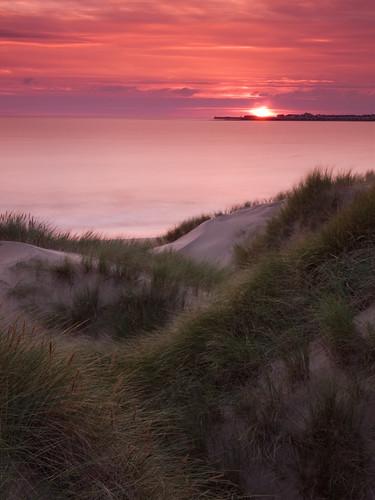 uk sunset grass southwales wales sanddunes hightide glamorganheritagecoast traethyrafon merthyrmawrwarren