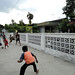 Bermain bola di jalan. : Children playing football in the street.  Photo by Ardian