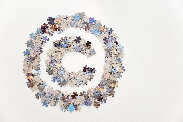 Large copyright sign made of jigsaw puzzle pieces
