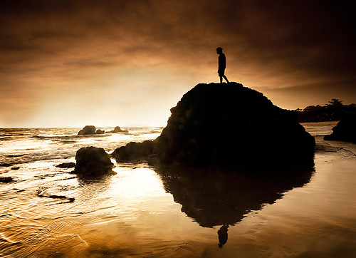 ocean california trees boy sunset reflection beach wet water up silhouette rock standing sand rocks surf waves candid filter lee rise carpinteria