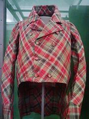 pattern(1.0), textile(1.0), clothing(1.0), sleeve(1.0), maroon(1.0), outerwear(1.0), design(1.0), tartan(1.0), pink(1.0), plaid(1.0),