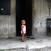 Anak didepan rumahnya. : A child in front of home. Photo by Ardian