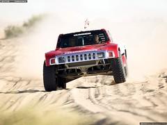 model car(0.0), auto racing(0.0), monster truck(0.0), world rally championship(0.0), sports car(0.0), automobile(1.0), rallying(1.0), racing(1.0), sport utility vehicle(1.0), vehicle(1.0), dirt track racing(1.0), off road racing(1.0), motorsport(1.0), off-roading(1.0), rally raid(1.0), land vehicle(1.0),