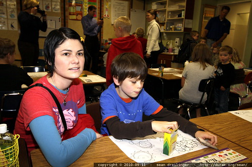 rachel sits with nick at his second grade desk