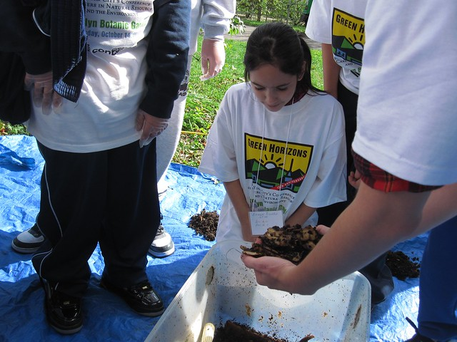 A Green Horizon student gets an up close view of compost made in a worm bin.