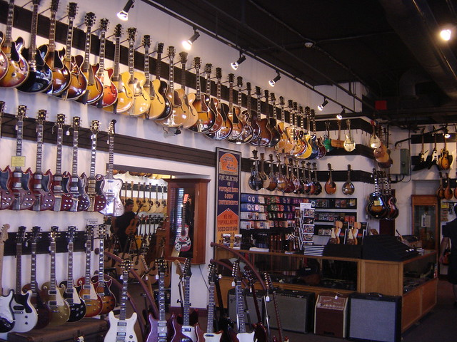 electric guitars hanging on the walls of gruhn 39 s guitar shop broadway nashville tennessee. Black Bedroom Furniture Sets. Home Design Ideas