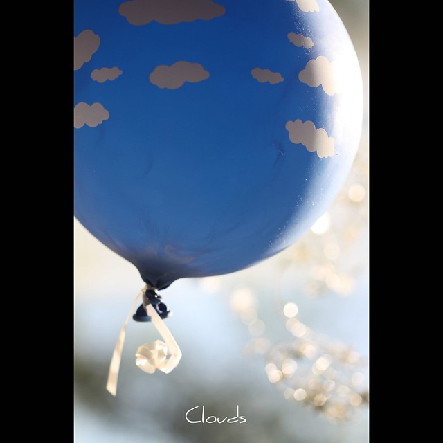 Clouds a blue balloon with pillowy white clouds floats for Silver cloud balloons