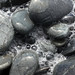 Sea water bubbles on pebbles