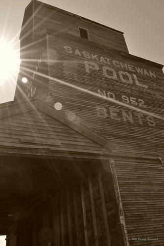 bw sunlight white black building abandoned sepia geotagged town nikon ghost flare saskatchewan grayscale sunspot grainelevator sask photoimpact starlight d60 bents wheatpool no952 geo:lat=5182089 geo:lon=107727568