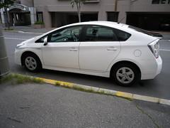 hatchback(0.0), automobile(1.0), automotive exterior(1.0), wheel(1.0), vehicle(1.0), compact car(1.0), bumper(1.0), toyota prius(1.0), land vehicle(1.0),