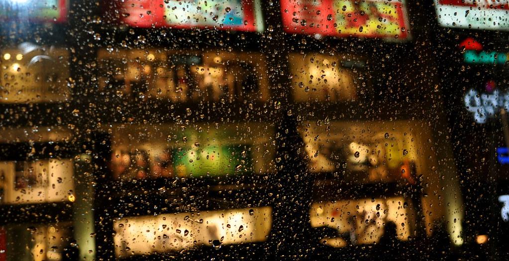 City lights through raindrops