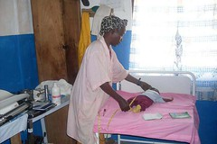 Midwife monitors the condition of an infant