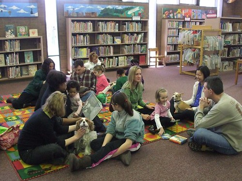 kids read to dogs at the library by Enoch Pratt Free Library