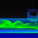 Dyed liquid flowing through clear tube during fluid dynamics experiment at Harvard's School of Engineering and Applied Sciences
