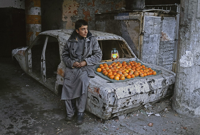 Boy selling oranges on the street, Kabul, Afghanistan, by Steve McCurry 2003