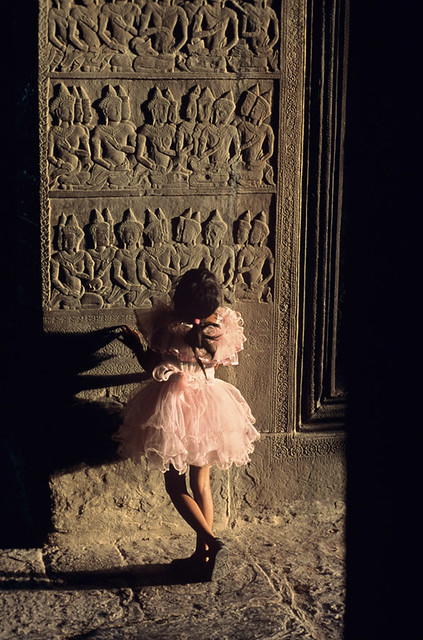 A little girl at Angkor Wat,  Angkor, Cambodia, 1998, by Steve McCurry