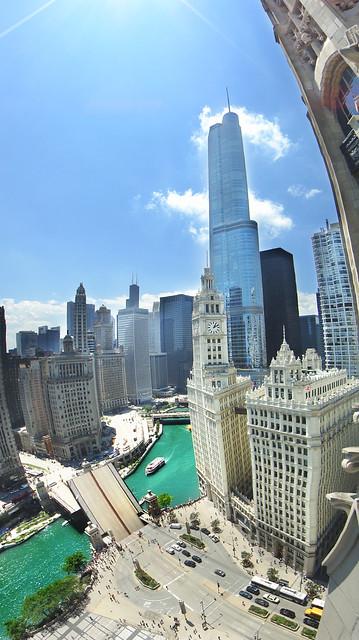 Panoramic of Michigan Avenue bridge opening over Chicago River