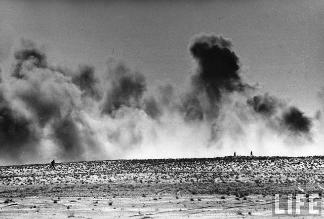 American soldiers charging into wall of smoke during a raid on German positions at Sened, by Eliot Elisofon 1943