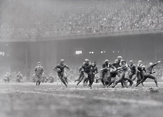 Red Grange scored touchdowns as the Chicago Bears Beat the Yellow Jackets to seven at Philadelphia, December 5. He's shown in above striking photo breaking loose around the entire Philadelphia Team on his way to a touchdown, Philadelphia 1925
