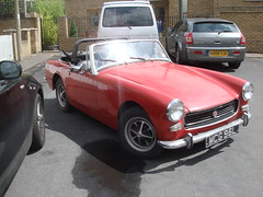 datsun roadster(0.0), austin-healey sprite(0.0), sports car(0.0), automobile(1.0), vehicle(1.0), mg midget(1.0), classic car(1.0), land vehicle(1.0), convertible(1.0),